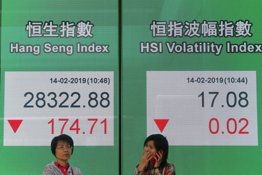 (AP Photo/Kin Cheung). Two women stand in front of an electronic board showing Hong Kong share index outside a bank in Hong Kong, Thursday, Feb. 14, 2019. Asian stocks were mostly lower on Thursday as China and the U.S. kicked off two days of trade neg...