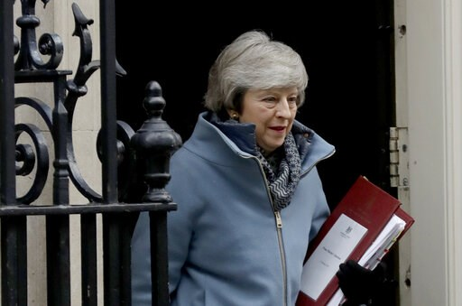 (AP Photo/Matt Dunham). British Prime Minister Theresa May leaves 10 Downing Street in London, to attend Prime Minister's Questions at the Houses of Parliament, Wednesday, Feb. 13, 2019.