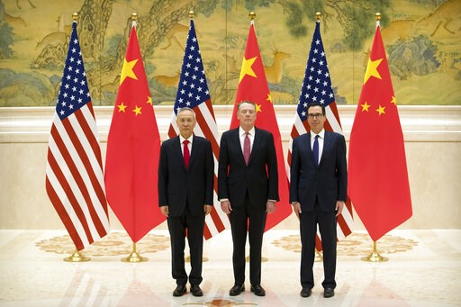 (AP Photo/Mark Schiefelbein, Pool). From left, Chinese Vice Premier and lead trade negotiator Liu He, U.S. Trade Representative Robert Lighthizer, and U.S. Treasury Secretary Steven Mnuchin pose for a photo before the opening session of trade negotiati...