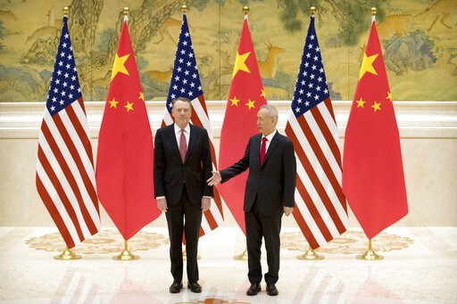 (AP Photo/Mark Schiefelbein, Pool). Chinese Vice Premier and lead trade negotiator Liu He, right, reaches to shake hands with U.S. Trade Representative Robert Lighthizer before the opening session of trade negotiations at the Diaoyutai State Guesthouse...
