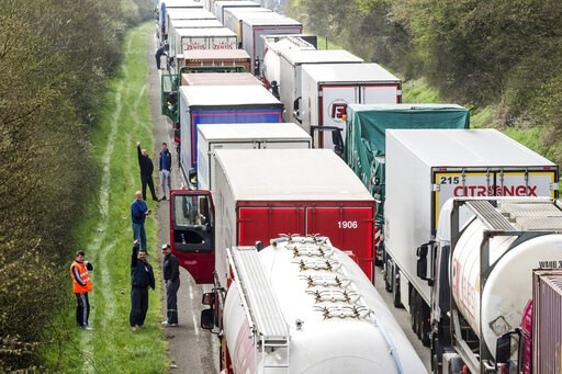 (AP Photo/Geert Vanden Wijngaert, File). FILE - In this April 6, 2016 file photo, truck drivers stand among trucks on the highway from Brussels to Luxembourg, in Spontin, Belgium. The European Union has reached a tentative agreement on the first specif...