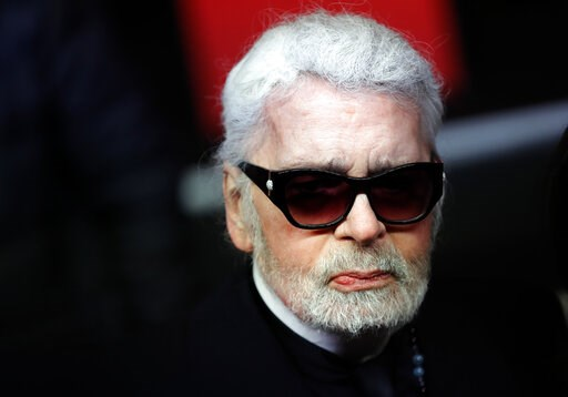 (AP Photo/Christophe Ena, File). FILE - In this Thursday, Nov. 22, 2018 file photo, Fashion designer Karl Lagerfeld poses during the Champs Elysee Avenue illumination ceremony for the Christmas season, in Paris. Chanel says Tuesday, Feb. 19, 2019 its i...