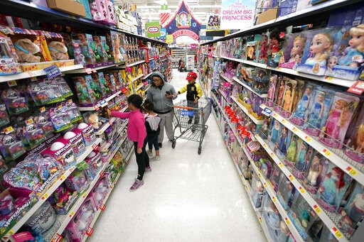 (AP Photo/David J. Phillip, File). FILE- In this Nov. 9, 2018, file photo shoppers look at toys at a Walmart Supercenter in Houston. Walmart Inc. reports financial results Tuesday, Feb. 19, 2019.