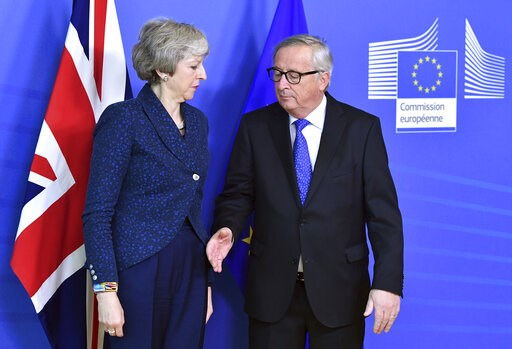 (AP Photo/Geert Vanden Wijngaert, file). In this Thursday, Feb. 7, 2019 photo European Commission President Jean-Claude Juncker, right, prepares to shake hands with British Prime Minister Theresa May, left, before their meeting at the European Commissi...