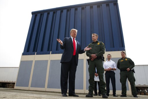 (AP Photo/Evan Vucci, File). FILE - In this March 13, 2018, file photo, President Donald Trump talks with reporters as he reviews border wall prototypes in San Diego. California's attorney general filed a lawsuit Monday, Feb. 18, 2019, against Trump's ...