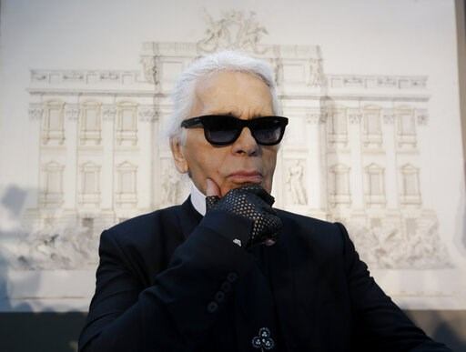 (AP Photo/Gregorio Borgia, File). FILE - In this Monday, Jan. 28, 2013 file photo, Karl Lagerfeld poses for photographers prior to the start of a press conference, in Rome. Chanel's iconic couturier, Karl Lagerfeld, whose accomplished designs as well a...