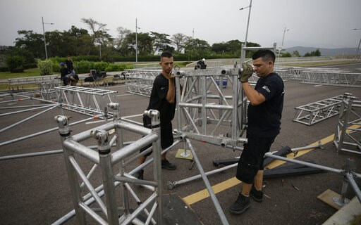 "(AP Photo/Fernando Vergara). Workers build the stage for an upcoming concert coined: ""Concert for the freedom of Venezuela"" on the Colombian side of the Tienditas International Bridge on the outskirts of Cucuta, Colombia, on the border with Venezuela, ..."