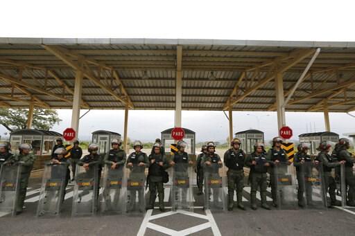 (AP Photo/Fernando Llano). Venezuelan Bolivarian Guardsmen stand guard at the Tienditas International Bridge that links Colombia and Venezuela, near Urena, Venezuela, Friday, Feb. 8, 2019. As humanitarian aid kits were being packed into individual whit...