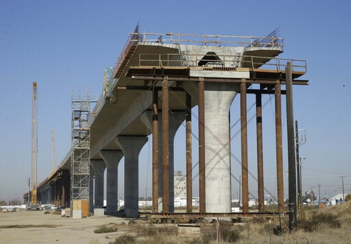 (AP Photo/Rich Pedroncelli, file). FILE - This Dec. 6, 2017, file photo shows one of the elevated sections of the high-speed rail under construction in Fresno, Calif. During his first State of the State speech last week, Gov. Gavin Newsom said that he ...