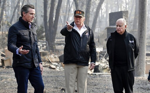 (AP Photo/Evan Vucci, File). FILE - In this Nov. 17, 2018, file photo, President Donald Trump talks with then Gov.-elect Gavin Newsom, left, and as California Gov. Jerry Brown listens during a visit to a neighborhood impacted by the wildfires in Paradi...