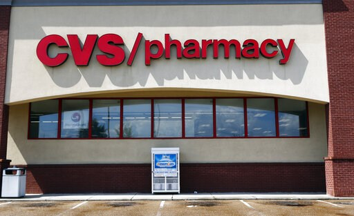 (AP Photo/Rogelio V. Solis, File). FILE- In this Aug. 7, 2018, file photo a CVS Pharmacy building sign rests on a Jackson, Miss., store. CVS Health Corp. reports financial results Wednesday, Feb. 20, 2019.
