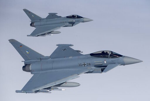 (AP Photo/Mindaugas Kulbis, file). File -- In this Tuesday, April 25, 2017 photo German Eurofighter Typhoon fighter jets participate in NATO's Baltic Air Policing Mission operate in Lithuanian airspace during an air force exercise. Britain's top diplom...