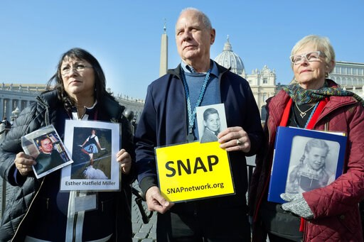 (AP Photo/Luigi Navarra). Survivors Network of those Abused by Priests (SNAP) President Tim Lennon from Tucson, AZ, center, and SNAP members Esther Hatfield Miller from Los Angeles, CA, left, and Carol Midboe from Austin, TX, pose for pictures during i...