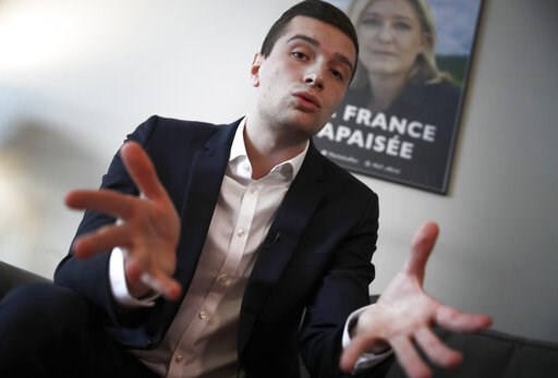 (AP Photo/Christophe Ena). Head of Marine Le Pen's party list for the European Parliament elections, Jordan Bardella speaks during an interview with Associated Press in Nanterre, outside Paris, Wednesday, Feb. 20, 2019.