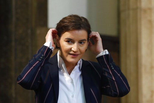 (AP Photo/Darko Vojinovic). In this photo taken on Monday, April 23, 2018, Serbia's Prime Minister Ana Brnabic gestures, at the Serbian Parliament building in Belgrade, Serbia. The office of Serbia's openly gay Prime Minister Ana Brnabic says her partn...