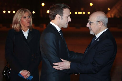 (Ludovic Marin, Pool Photo via AP). CRIF president Francis Kalifat, right, welcomes France's President Emmanuel Macron and his wife Brigitte Macron at the Louvre Carrousel as they arrive to attend the 34rd annual dinner of the group CRIF, Representativ...