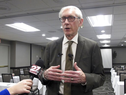 (AP Photo/Scott Bauer). Wisconsin Gov. Tony Evers talks to reporters Wednesday, Feb. 20, 2019, in Madison, Wis. Evers says he anticipates not supporting a Republican middle class tax cut bill that passed with no Democratic votes.