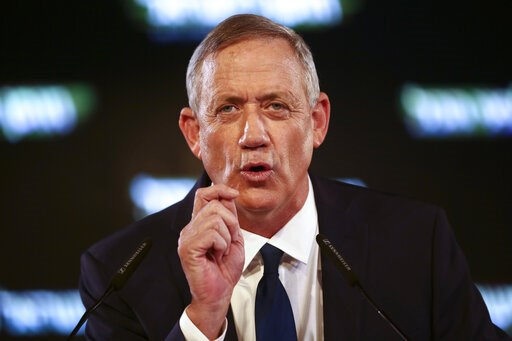 (AP Photo/Oded Balilty, File). FILE - In this Jan. 29, 2019, file photo, former Israeli Chief of Staff Benny Gantz speaks at the official launch of his election campaign in Tel Aviv, Israel. Gantz and Yair Lapid, head of the Yesh Atid party, said early...