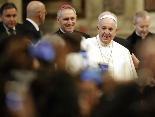 (AP Photo/Alessandra Tarantino). Pope Francis arrives in St. Peter's Basilica at the Vatican for a audience with pilgrims coming from the diocese of Benevento, Wednesday, Feb. 20, 2019.