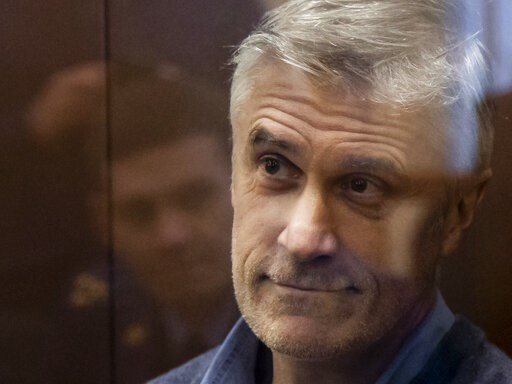 (AP Photo/Alexander Zemlianichenko). Founder of the Baring Vostok investment fund Michael Calvey looks through a cage's class in the court room in Moscow, Russia, Saturday, Feb. 16, 2019. A Moscow court has ordered Baring Vostok's founder Michael Calve...