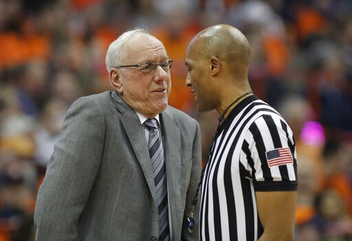 (AP Photo/Nick Lisi). Syracuse head coach Jim Boeheim, left, talks to an official about a call during the second half of an NCAA college basketball game against Louisville in Syracuse, N.Y., Wednesday, Feb. 20, 2019. Syracuse won 69-49.