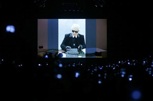 (AP Photo/Antonio Calanni). A video presentation showing the late designer Karl Lagerfeld and his association with Fendi is shown after the Fendi women's Fall-Winter 2019-2020 collection, that was presented in Milan, Italy, Thursday, Feb.21, 2019.