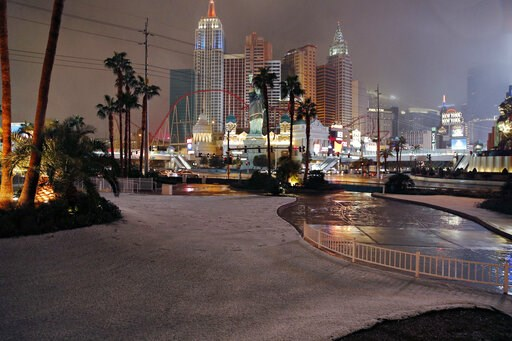 (AP Photo/John Locher). A dusting of snow covers an area along the Las Vegas Strip, Thursday, Feb. 21, 2019, in Las Vegas. A winter storm is expected to drop up to 3 inches (8 centimeters) of snow on Las Vegas' southern and western outskirts while othe...