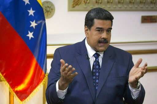 (AP Photo/Ariana Cubillos, File). FILE - In this Feb. 14, 2019 file photo, Venezuela's President Nicolas Maduro speaks during an interview at Miraflores presidential palace in Caracas, Venezuela. Maduro said Wednesday, Feb. 20, 2019, that 300 metric to...