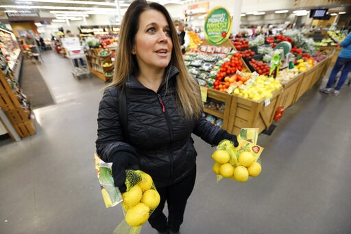 (AP Photo/Charlie Neibergall). In this Friday, Jan. 18, 2019, photo, Jamie Shae, of Grimes, Iowa, talks about the lemons she found in the imperfect produce section at the Hy-Vee grocery store in Urbandale, Iowa. She didn't realize there was anything sp...