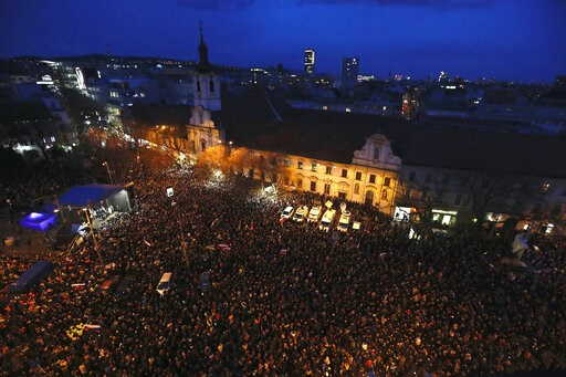 (AP Photo/Petr David Josek). People gather on a square during a rally to mark one year anniversary of the slayings of an investigative reporter and his fiancee, in Bratislava, Slovakia, Thursday, Feb. 21, 2019.  Jan Kuciak and Martina Kusnirova were sh...