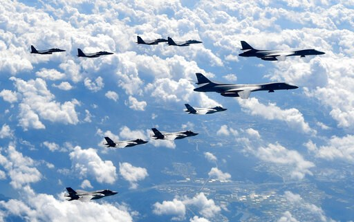 (South Korea Defense Ministry via AP, File). FILE - In this Sept. 18, 2017, file photo provided by South Korea Defense Ministry, U.S. Air Force B-1B bombers, F-35B stealth fighter jets and South Korean F-15K fighter jets fly over the Korean Peninsula d...