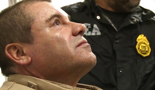 """(United States Drug Enforcement Administration via AP). FILE- In this Jan. 19, 2017 file photo provided by the United States Drug Enforcement Administration, Mexican drug kingpin Joaquin """"El Chapo"""" Guzman arrives at Long Island MacArthur Airport in Ron..."""