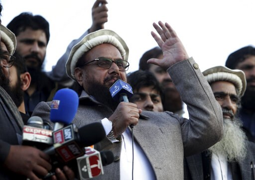 (AP Photo/K.M. Chaudary, File). File - In this Feb. 5, 2019 file photo, Hafiz Saeed, chief of Pakistani religious group Jamaat-ud-Dawa, addresses a rally in Lahore, Pakistan. Pakistan has re-imposed a ban on two charities run by a U.S.-wanted suspect b...
