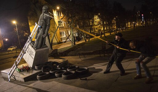 (AP Photo/Bartek Sabela/Gazeta Wyborcza). Activists in Poland pull down a statue of a prominent deceased priest, Father Henryk Jankowski, who allegedly abused minors sexually, in Gdansk, Poland, on Thursday Feb. 21, 2019. The activists said it was an a...