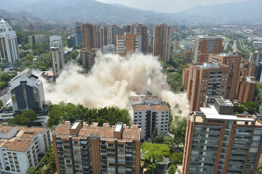 (AP Photo/Luis Benavidez). Clouds of dust rise from the implosion of a six-floor apartment building that former cartel boss Pablo Escobar once called home, in Medellin, Colombia, Friday, Feb. 22, 2019. Mayor Federico Gutierrez had been pushing to raze ...