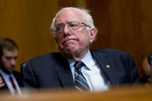 (AP Photo/Andrew Harnik, File). FILE - In this Jan. 16, 2019, photo, Sen. Bernie Sanders, I-Vt., reacts during a hearing on Capitol Hill in Washington. The growing Democratic presidential field is increasingly splitting into two camps: those who want t...
