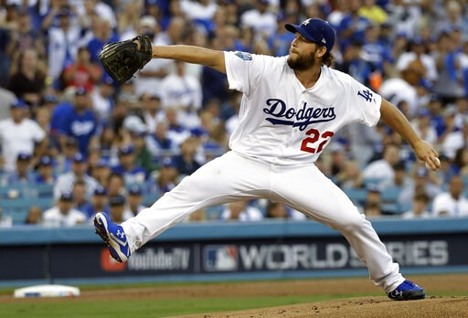 (AP Photo/David J. Phillip, File). FILE - In this Oct. 28, 2018, file photo, Los Angeles Dodgers pitcher Clayton Kershaw winds up during the first inning in Game 5 of the World Series baseball game against the Boston Red Sox in Los Angeles. Kershaw has...