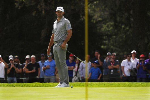 (AP Photo/Marco Ugarte). Dustin Johnson watches his putt on the 2nd green on the second day of competition of the WGC-Mexico Championship at the Chapultepec Golf Club in Mexico City, Friday, Feb. 22, 2019.