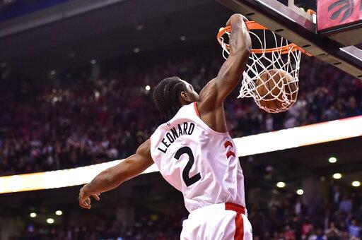 (Frank Gunn/The Canadian Press via AP). Toronto Raptors forward Kawhi Leonard dunks against the San Antonio Spurs in the final minute of an NBA basketball game Friday, Feb. 22, 2019, in Toronto.