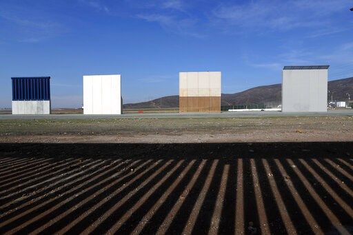 (AP Photo/Moises Castillo, File). FILE - In this Wednesday, Dec. 12, 2018, file photo, border wall prototypes stand in San Diego near the Mexico-U.S. border, seen from Tijuana, Mexico, where the current wall casts a shadow in the foreground. Customs an...