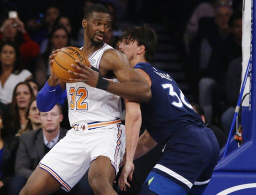 (AP Photo/Frank Franklin II). New York Knicks' Noah Vonleh (32) is defended by Minnesota Timberwolves' Dario Saric (36) during the first half of an NBA basketball game Friday, Feb. 22, 2019, in New York.