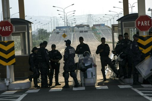 (AP Photo/Rodrigo Abd). Policemen stand guard during a concert at Tienditas International Bridge, in Venezuela, Friday, Feb. 22, 2019, on the border with Colomcia. Venezuela's power struggle is set to convert into a battle of the bands Friday when musi...