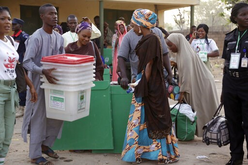 (AP Photo/Sunday Alamba). Electoral officials carry ballot boxes before the Presidential and National Assembly election in Yola, Nigeria, Saturday, Feb. 23, 2019. Africa's most populous country goes to the polls on Saturday to decide whether President ...
