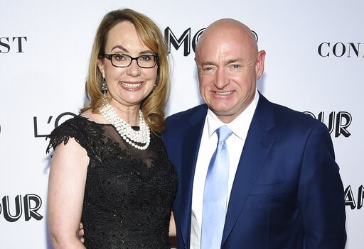 (Photo by Evan Agostini/Invision/AP, File). FILE- In this Nov. 12, 2018, file photo politician and gun control advocate Gabrielle Giffords and husband, retired astronaut Mark Kelly, attend the Glamour Women of the Year Awards at Spring Studios in New Y...