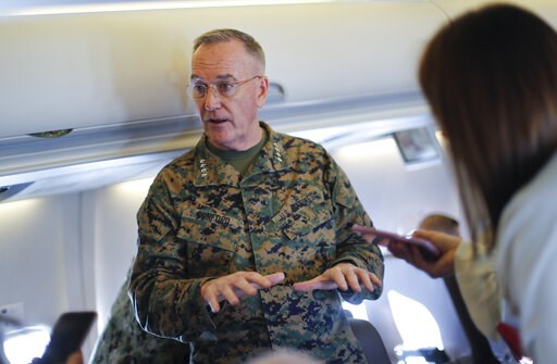 (AP Photo/Pablo Martinez Monsivais, Pool). Joint Chiefs Chairman Gen. Joseph Dunford gestures while speaking to reporters during a briefing on a military aircraft before arrival at El Paso International airport, Saturday, Feb. 23, 2019. Dunford is trav...