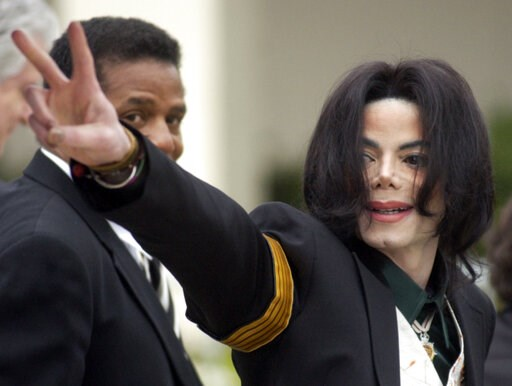 (AP Photo/Michael A. Mariant, File). FILE - In this March 2, 2005, file photo, pop icon Michael Jackson waves to his supporters as he arrives for his child molestation trial at the Santa Barbara County Superior Court in Santa Maria, Calif. A new docume...