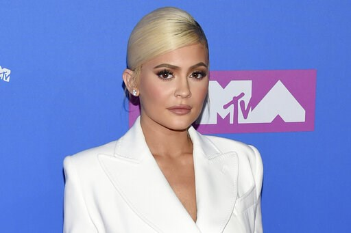 (Photo by Evan Agostini/Invision/AP). FILE - In this Monday, Aug. 20, 2018 file photo, Kylie Jenner arrives at the MTV Video Music Awards at Radio City Music Hall in New York. At 21, Jenner has been named the youngest-ever, self-made billionaire by For...