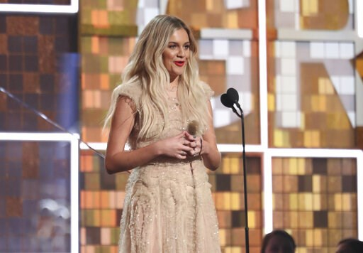 (Photo by Matt Sayles/Invision/AP, File). FILE - In this Feb. 10, 2019, file photo, Kelsea Ballerini introduces a performance by Brandi Carlile at the 61st annual Grammy Awards in Los Angeles. Country group Little Big Town surprised Ballerini on Tuesda...