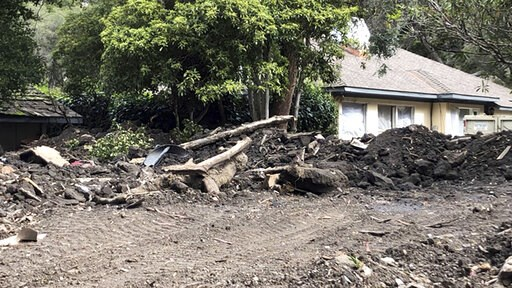 (John Palminteri/KEYT-TV via AP). This photo provided by KEYT-TV shows a damaged home Tuesday, March 5, 2019, more than a year after devastating floods hit this Montecito, Calif., neighborhood. The Santa Barbara County Sheriff's Office on Tuesday order...
