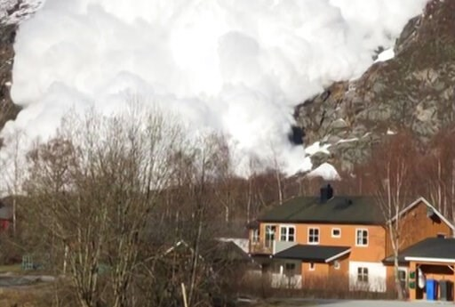 (AP Photo/Gunn Gravem Isaksen). In this photo taken from amateur video, an avalanche cascades down the mountain-side towards the village of Sundal, Norway, Tuesday March 5, 2019. The amateur video shows the avalanche racing down the side of a mountain ...